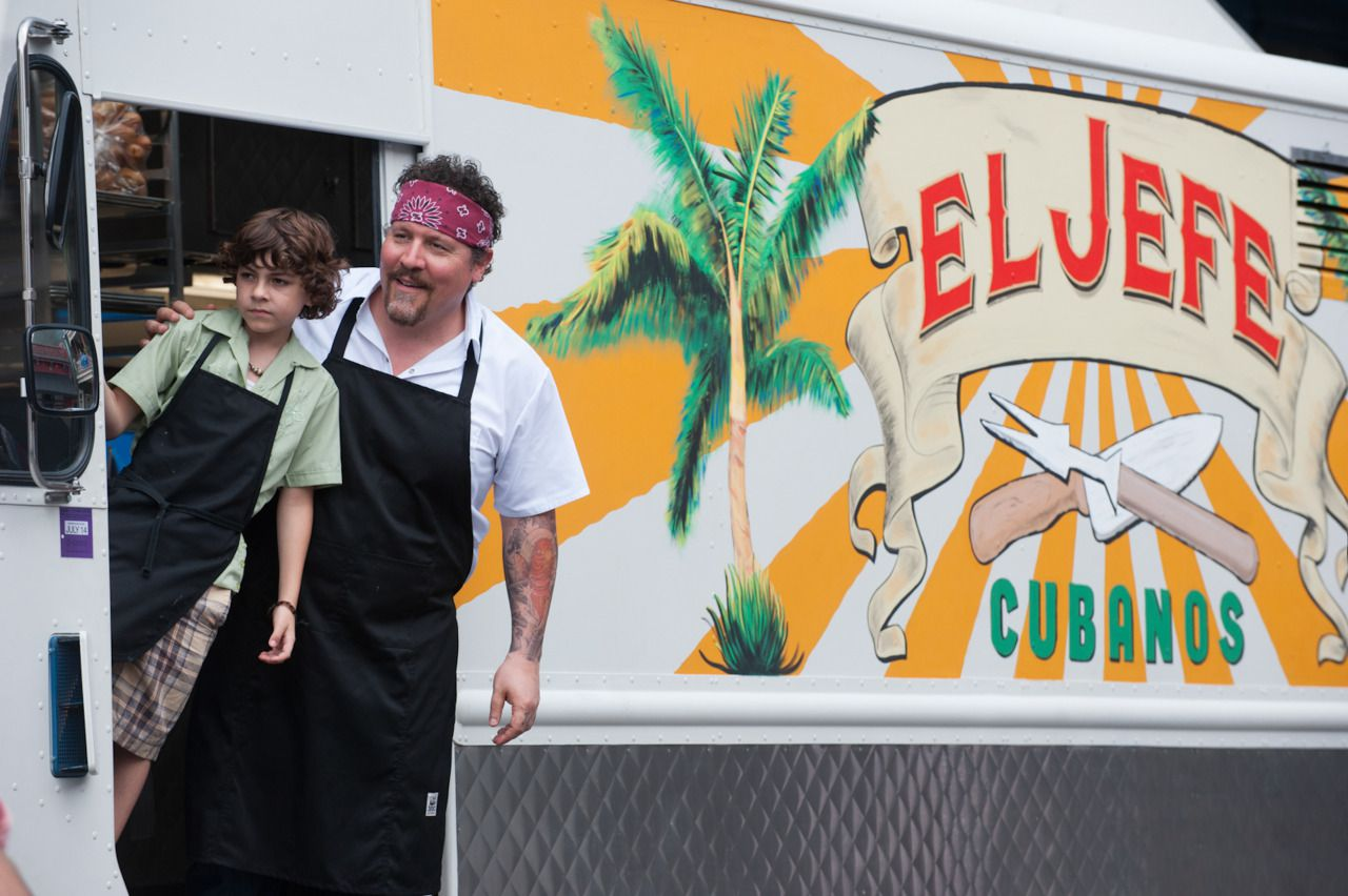 Scene of the food truck and father and son in Chef