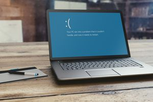 Windows 10 PC laptop with Blue Screen of Death on its screen