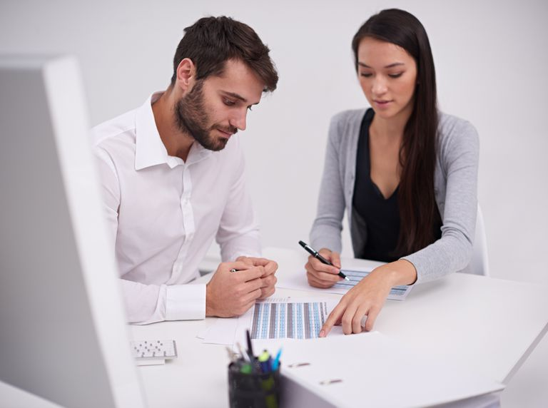 Image of two people reviewing data in a spreadsheet