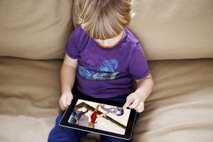 A young boy watching video footage on an iPad.