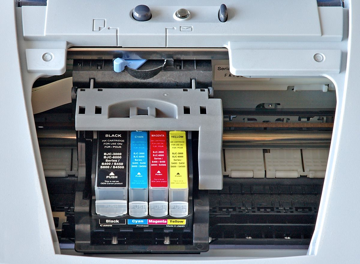 Ink cartridges in an inkjet printer ready to be cleaned