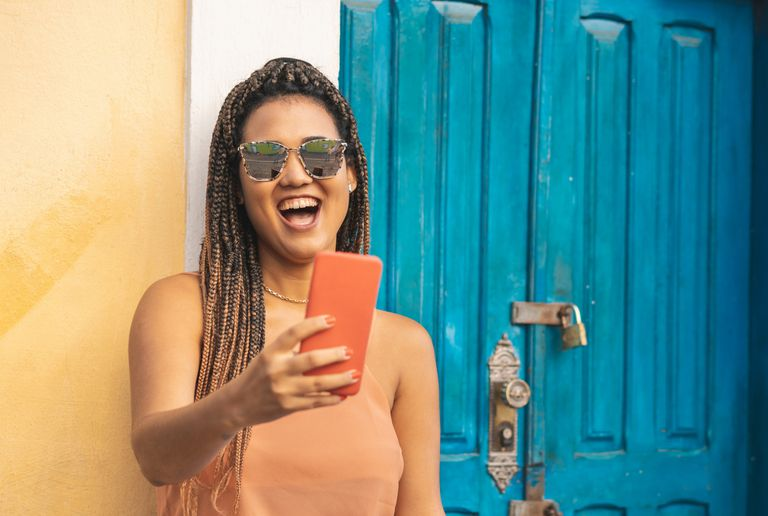 Girl in sunglasses video chatting on mobile phone