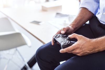 A man tries to use his PS4 controller.