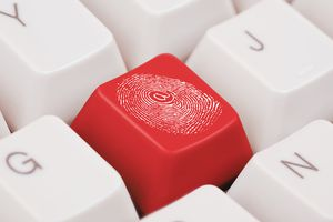 Fingerprint on red key for a keyboard