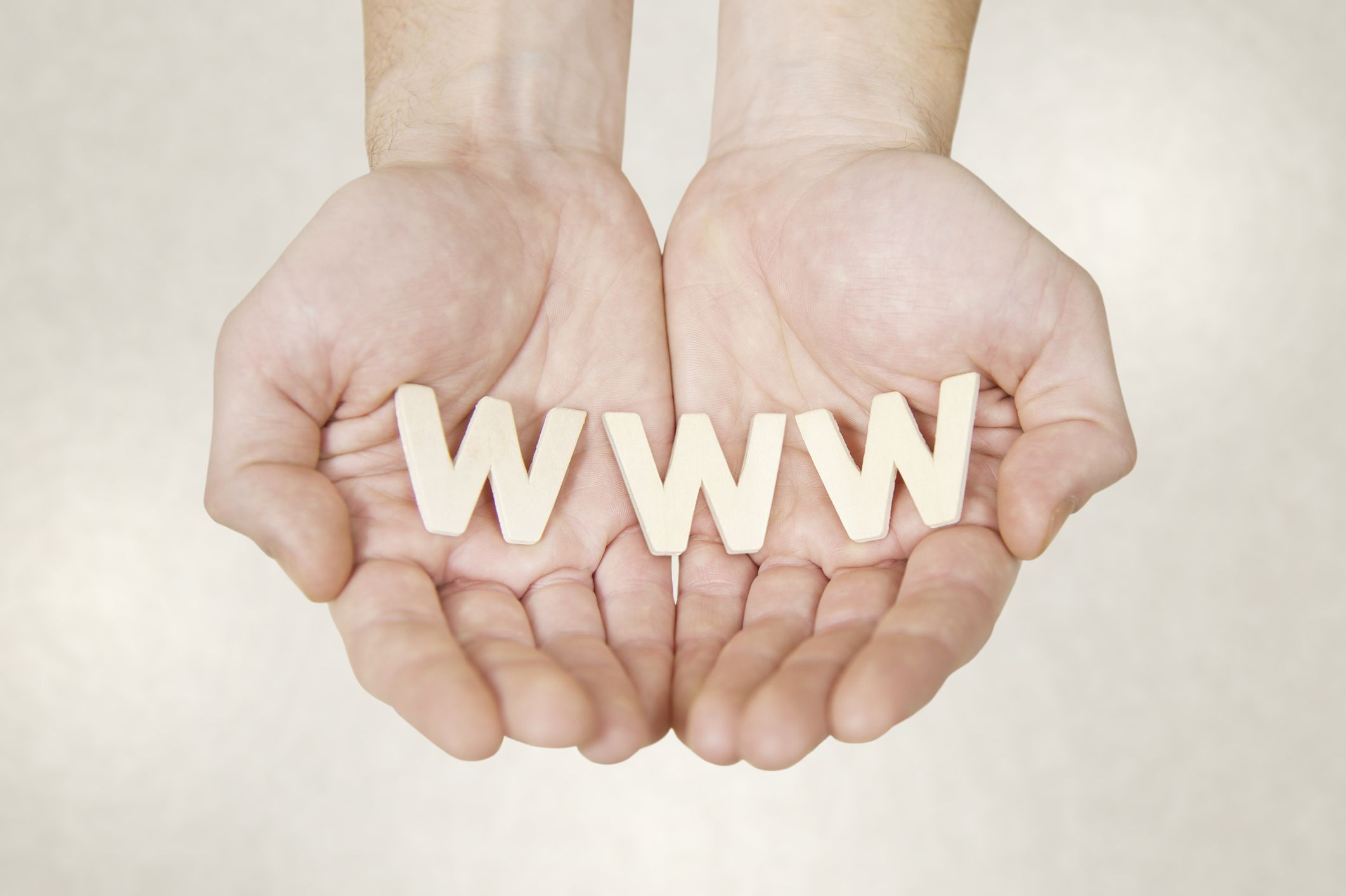 world wide web letter blocks being held by hands