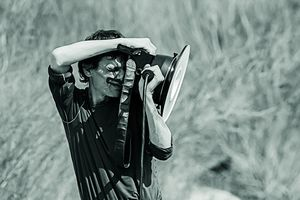 A monochrome image of a photographer at work.