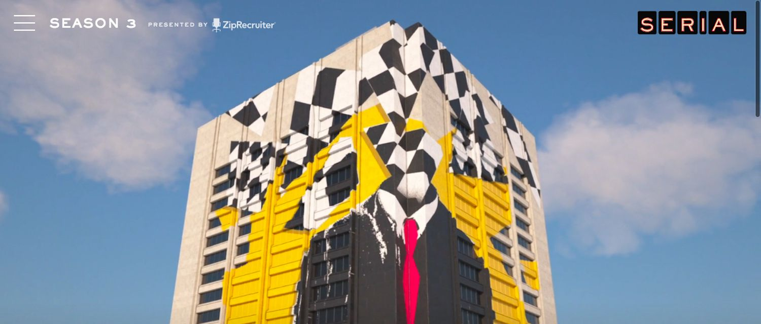 Large building with the abstract picture of a man whose head is an array of checkerboard squares.