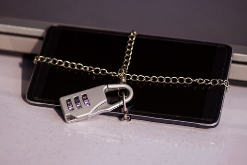Smartphone locked with chain and number lock