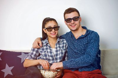 Young Couple Watching 3D Movie at Home