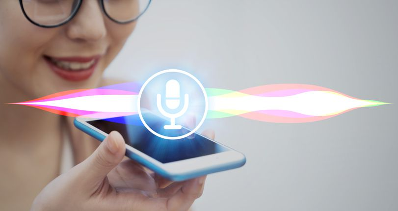 Woman uses voice recognition with smart phone
