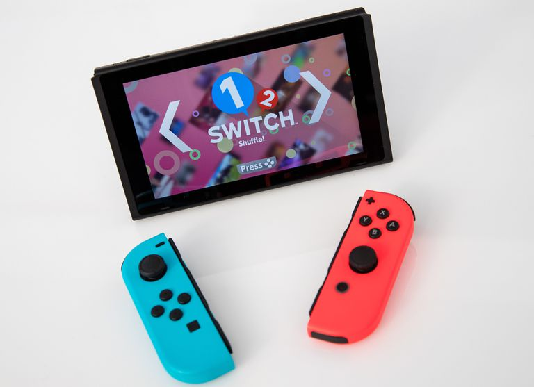 A Nintendo Switch console and Joy-Con controllers
