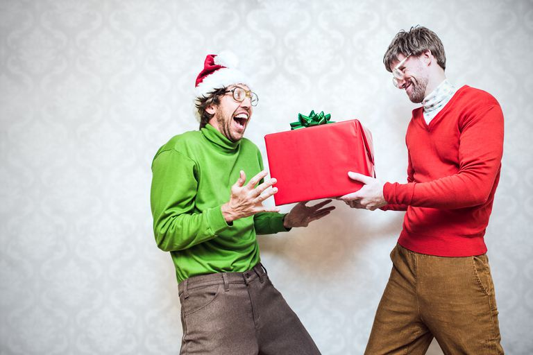 Two geeks exchanging presents