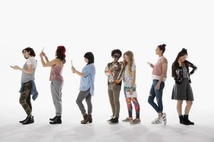 A group of people using iPhones