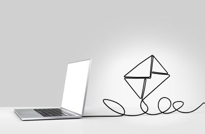 Laptop with cord twisted into an envelope