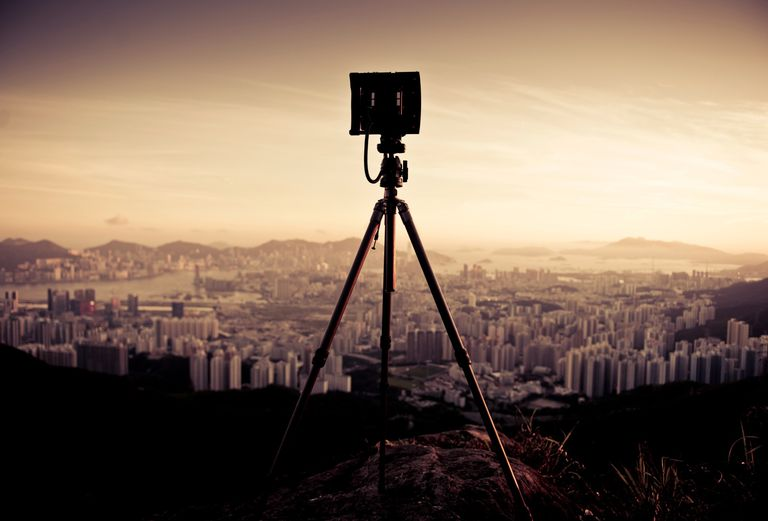 Camera tripod overlooking a city
