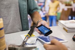A shopper using contactless payment