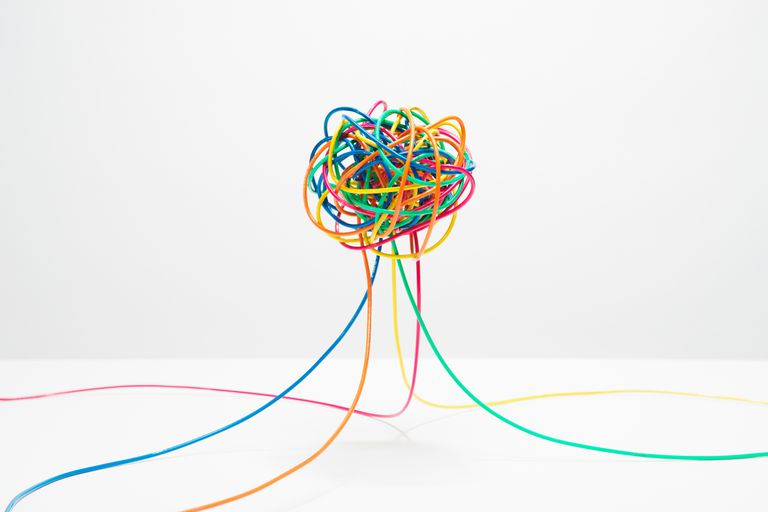 Many colored wires coming together into a knotted ball