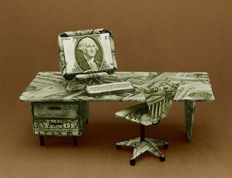 Office desk with computer made from US dollar bills