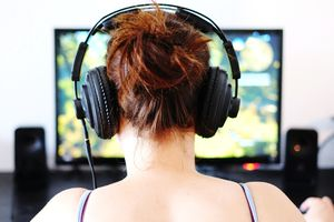 Redhaired woman streaming a video game on Twitch