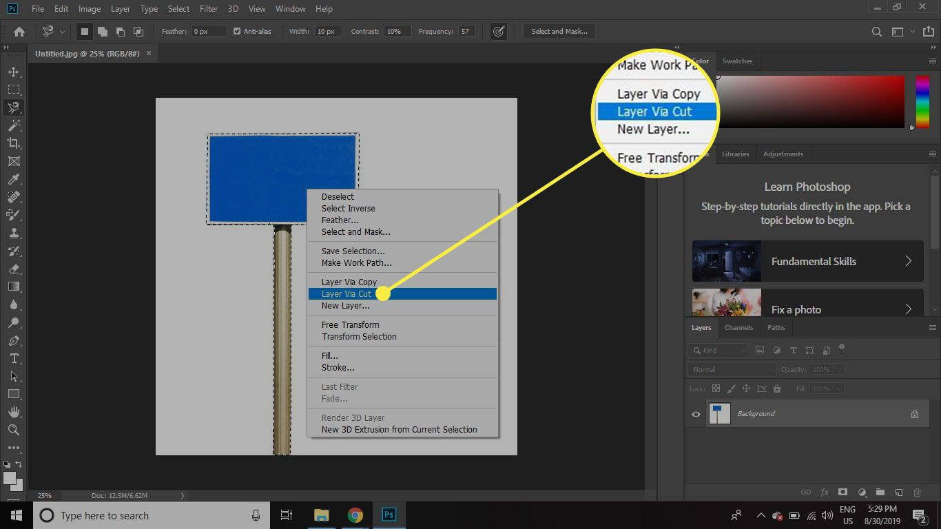 A screenshot of Photoshop with the Layer Via Cut command highlighted