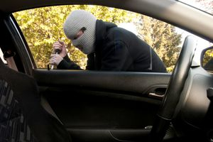 Masked Man Breaking into a Car