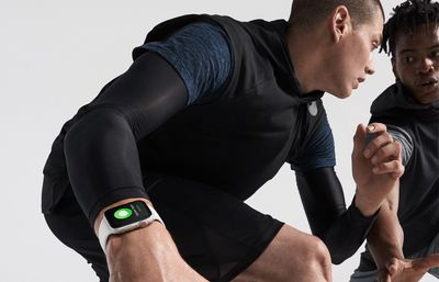 Two men playing basketball -- one wears an Apple Watch
