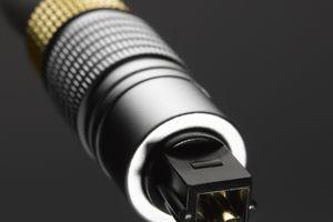A close up view of a fiber optic digital audio cable