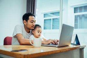 Father and young son at laptop