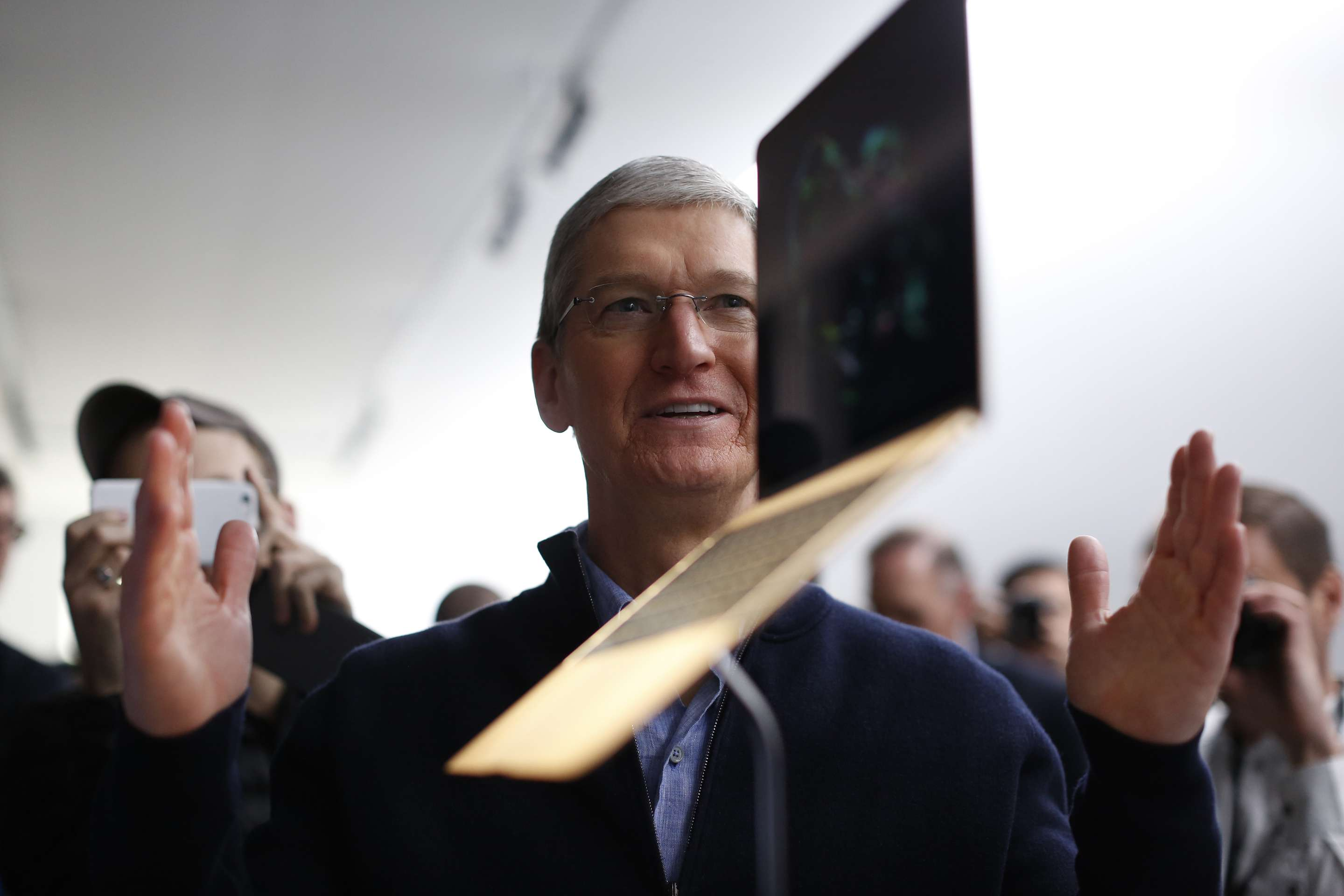 Apple CEO Tim Cook with a MacBook