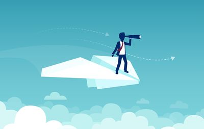 A businessman flying on a paper plane searching with a telescope