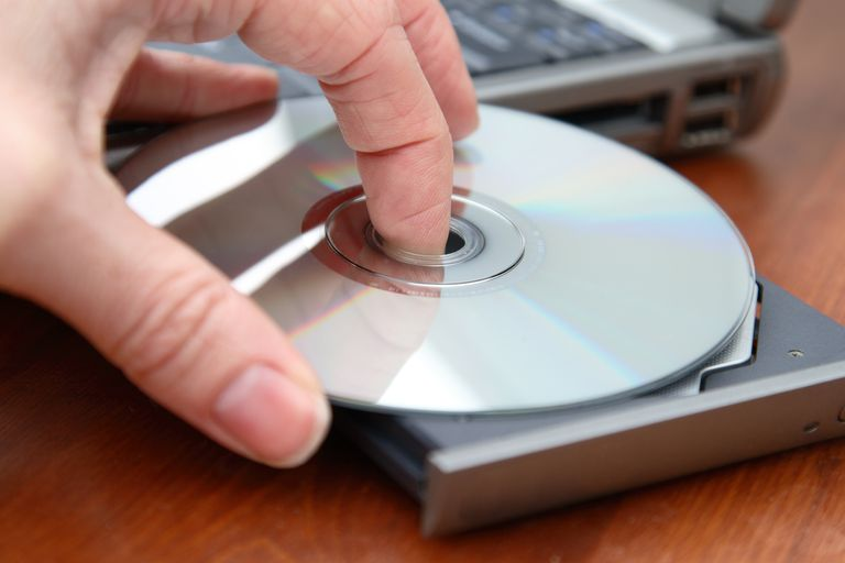 Inserting DVD into disc tray
