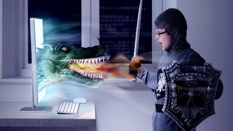A green dragon coming out of a computer and attacking a young boy wearing knight armor