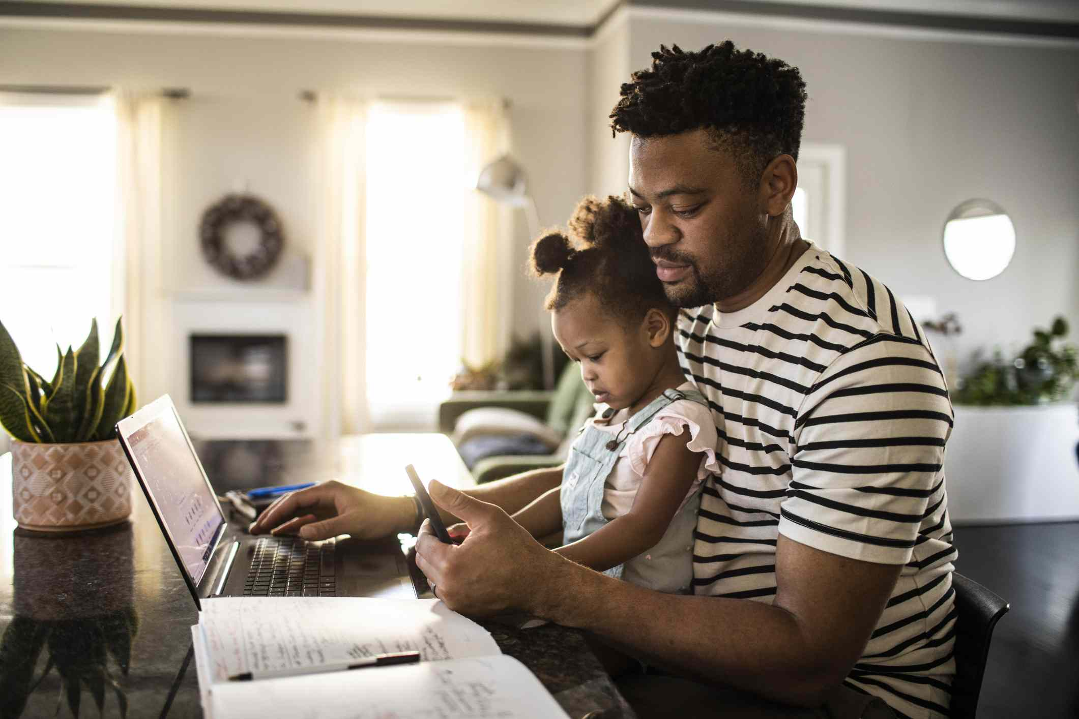 Man with daughter on computer