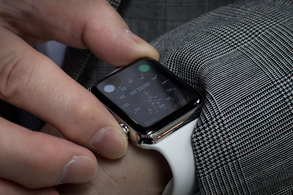 Close up of person using Apple Watch in a suit