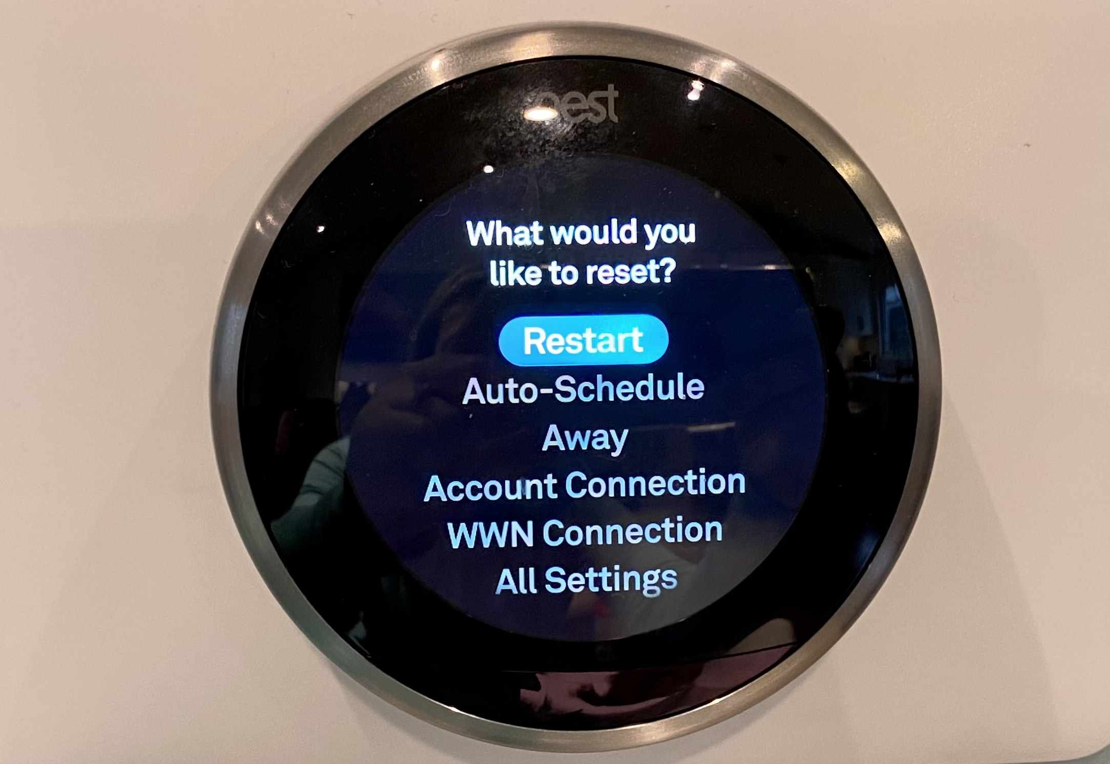 The menu on the Nest thermostat selecting Restart.