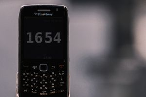 black BlackBerry smartphone showing a time of 16:54pm