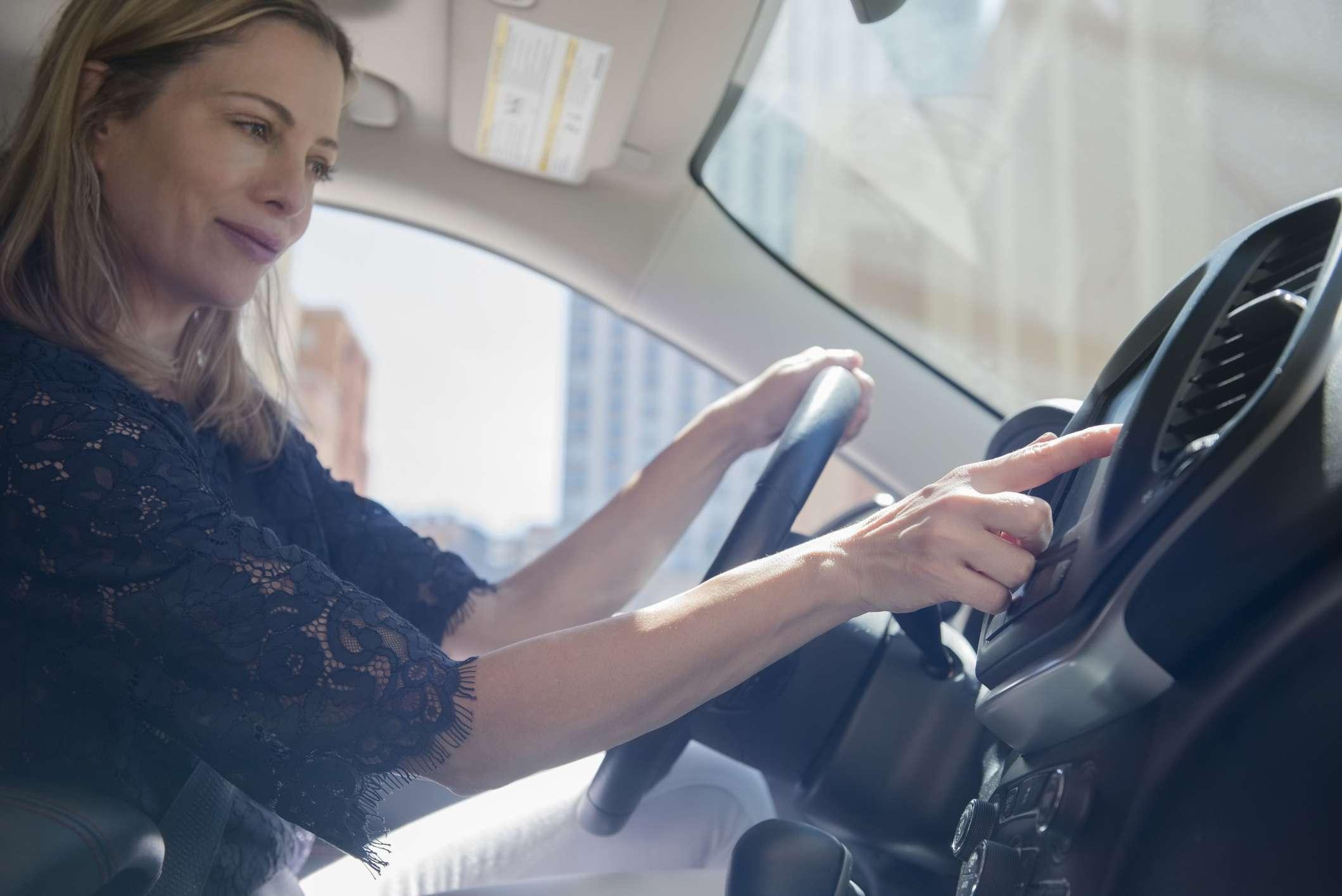 Woman using car dashboard system