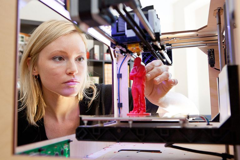 Woman using 3D printer