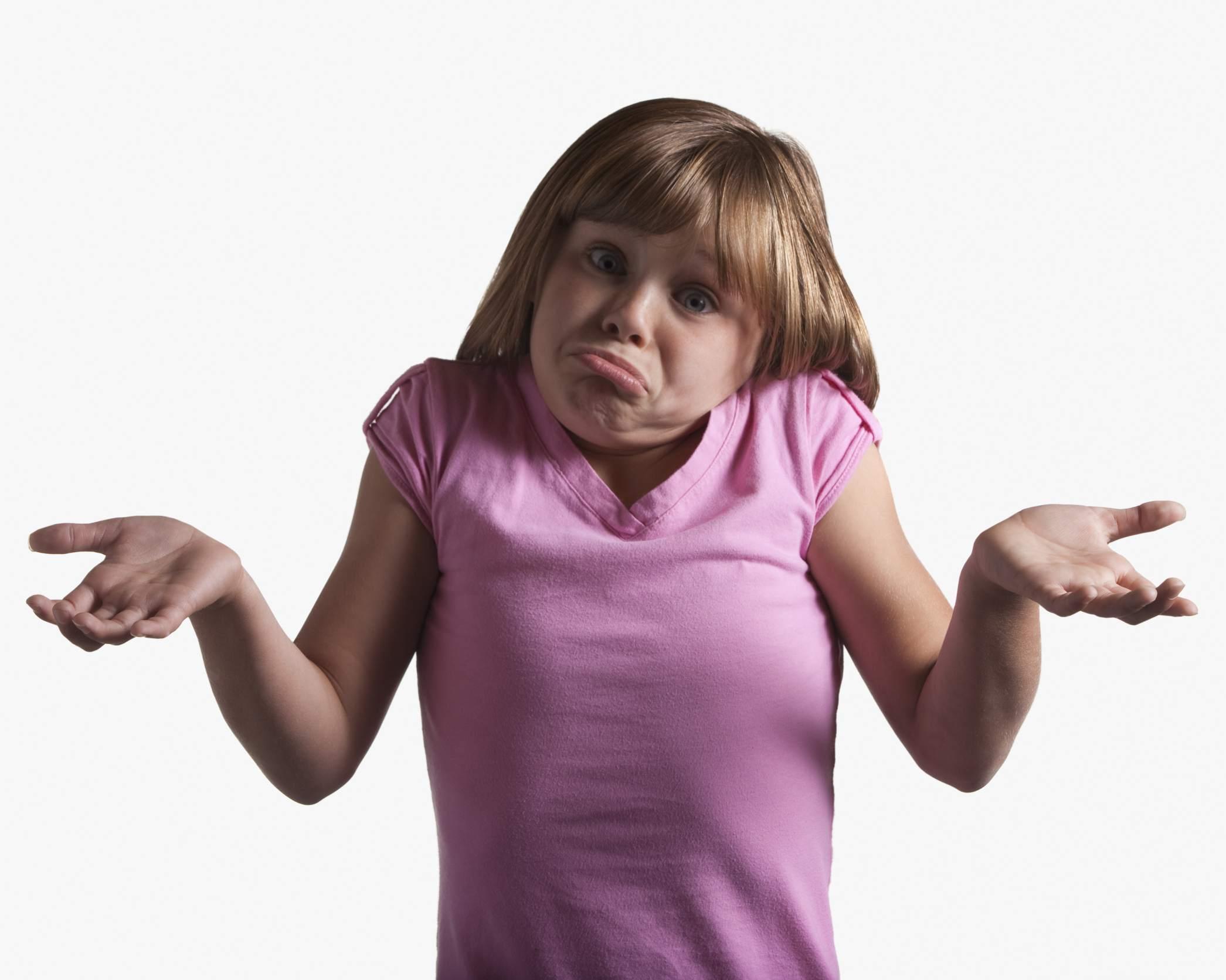 Young girl shrugging
