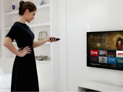 A person checking the apps on a Fire Stick.