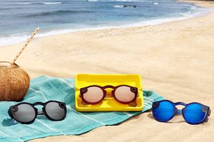 Three pairs of Snapchat spectacles on a beach