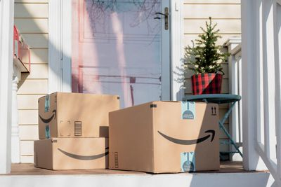 Amazon boxes on a front porch.
