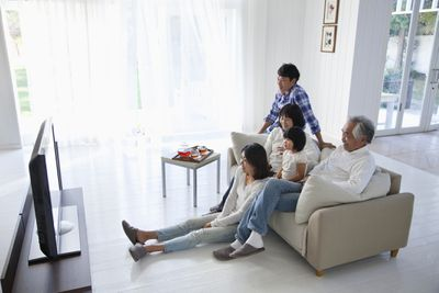 Family watching 42 inch TV