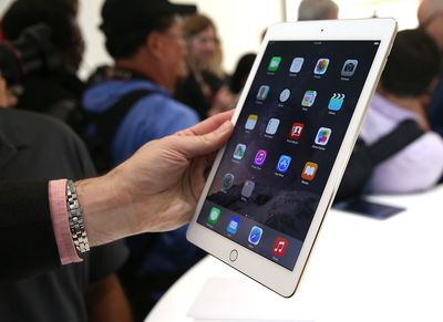 Woman holds iPad at the Apple Store
