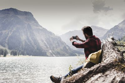 Hiker taking photo with smartphone