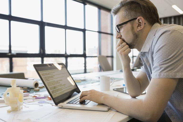 Man working on Mac computer
