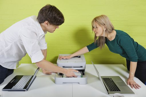 People working with printer