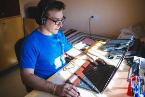 Man playing video game on laptop