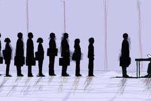 Job seekers wait to talk to employer