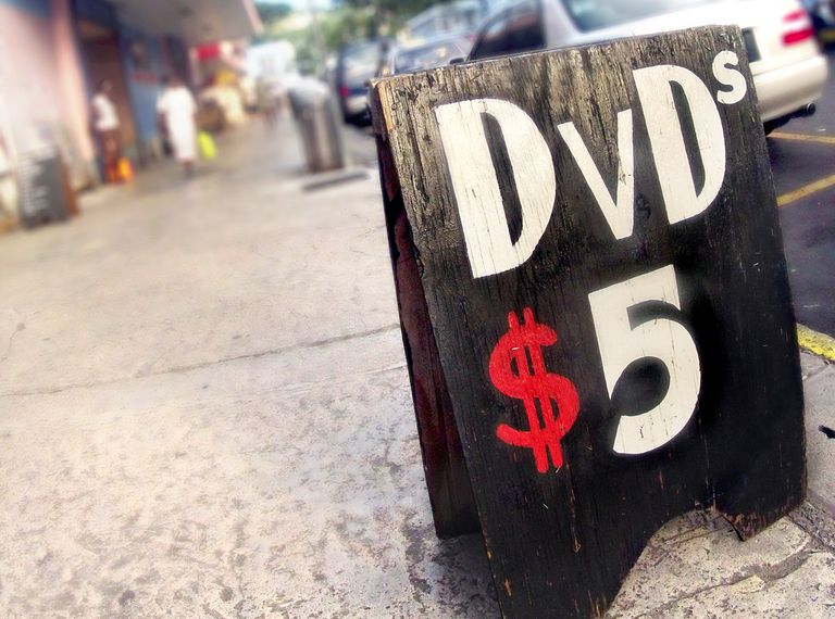 Sign for selling DVDs for $5